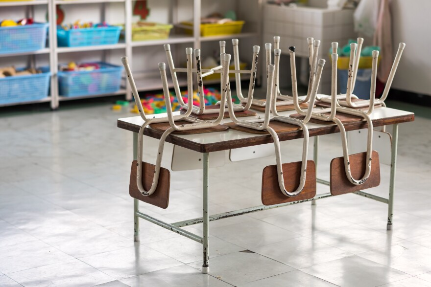 Photo of small chairs on a small table in a classroom