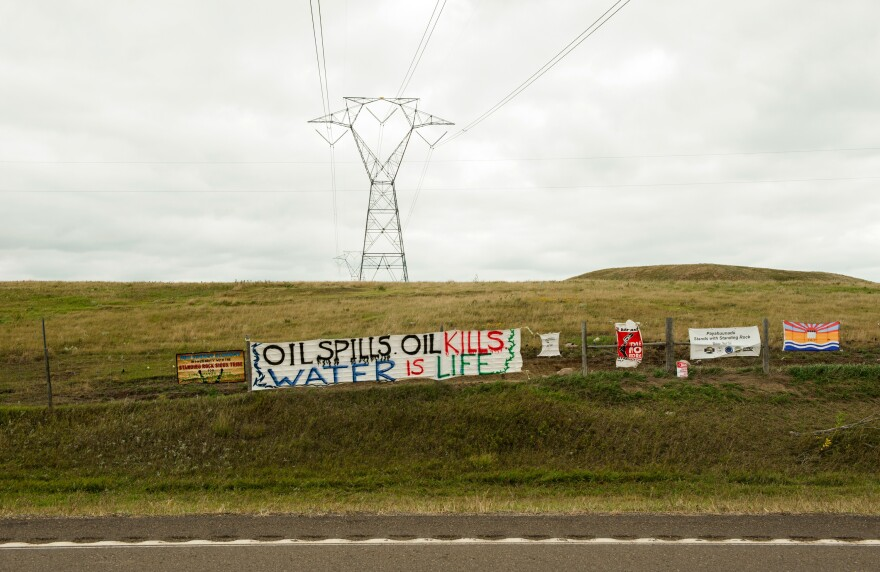 Signs left by protesters at a pipeline construction site a mile away from the Standing Rock Sioux reservation.