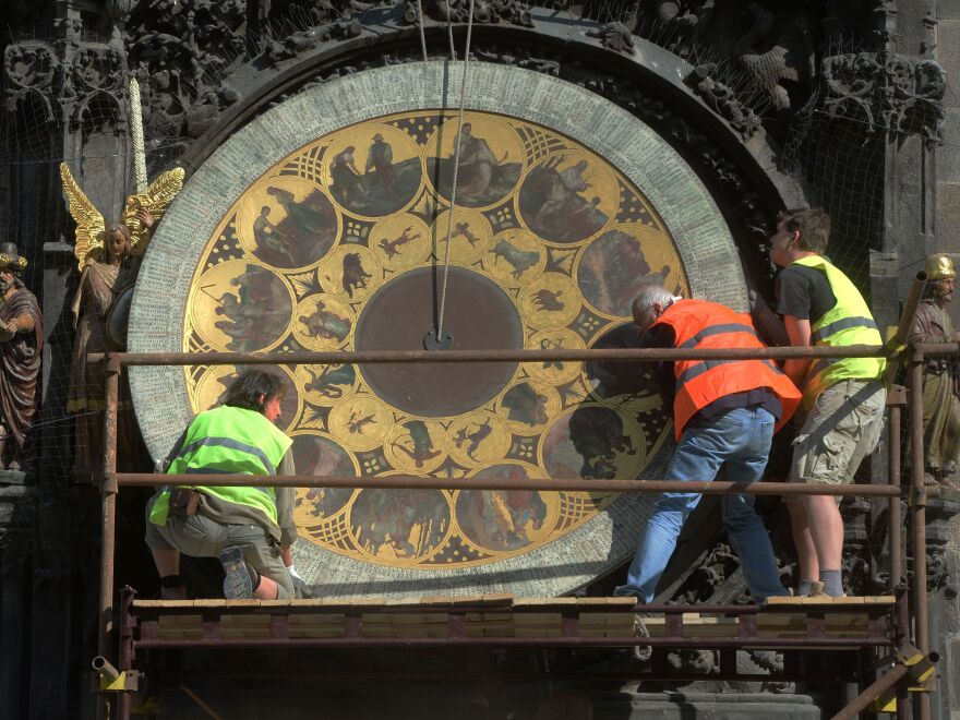 Members of the European Parliament have voted to abolish daylight saving time in the EU. Here, workers remove the calendar dial of Prague's astronomical clock during a renovation of the building in 2017.