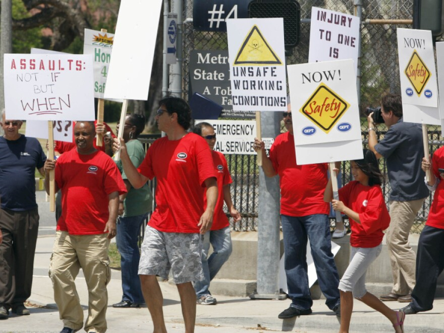 Metropolitan State Hospital employees and supporters gather outside the gates of the hospital in Norwalk, Calif., earlier this month to protest repeated assaults at the hands of mental patients and what they call dangerous working conditions.