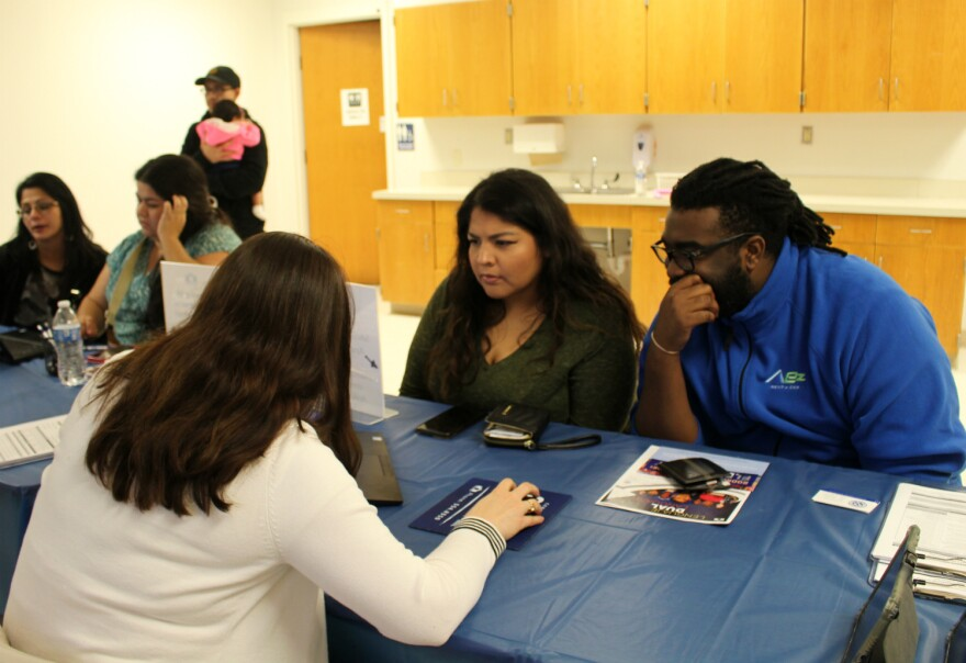 Jessica Siller and her husband Amzi Austin fill out an application for their daughter during an information night at Rodriguez Elementary Jan. 16, 2020.