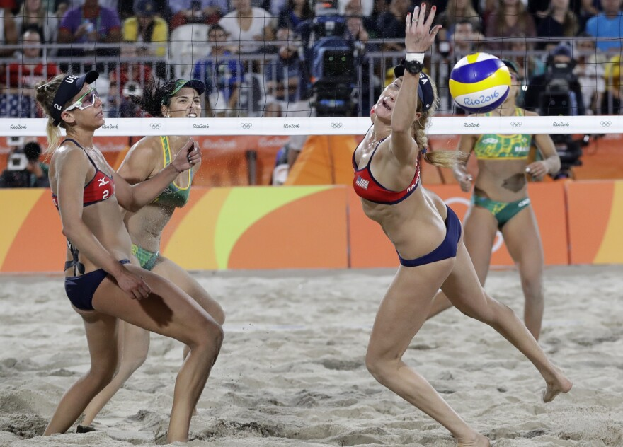 April Ross (left) watches her U.S. teammate Kerri Walsh Jennings try to reach the ball during a women's beach volleyball semifinal match early Wednesday. The Americans lost in straight sets to the Brazilians, 22-20 and 21-18, ending Walsh Jennings' quest for a fourth straight gold.