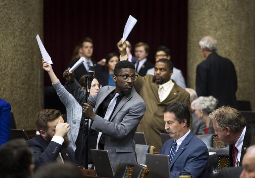 House Democrats, including Bruce Franks Jr., raise their hands to speak about the $10-an-hour minimum wage in St. Louis on the last day of the 2017 legislative session.