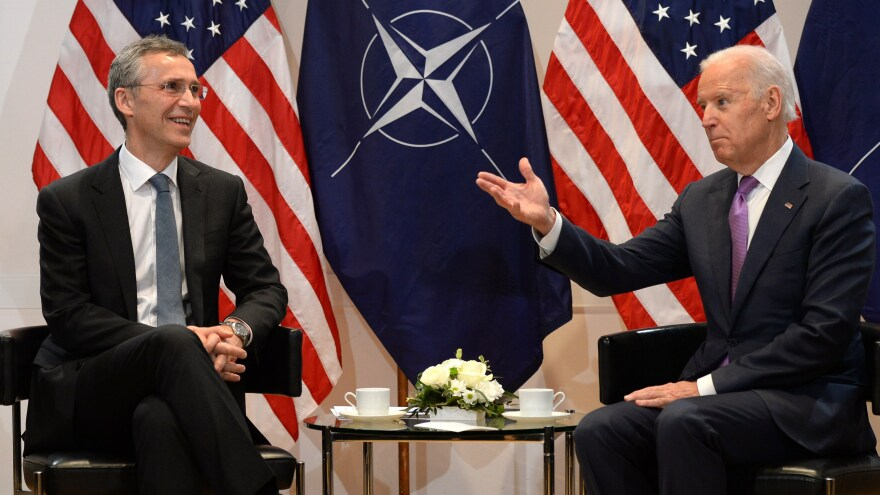 NATO Secretary General Jens Stoltenberg and then-Vice President Joe Biden talk during the 51st Munich Security Conference in February 2015.