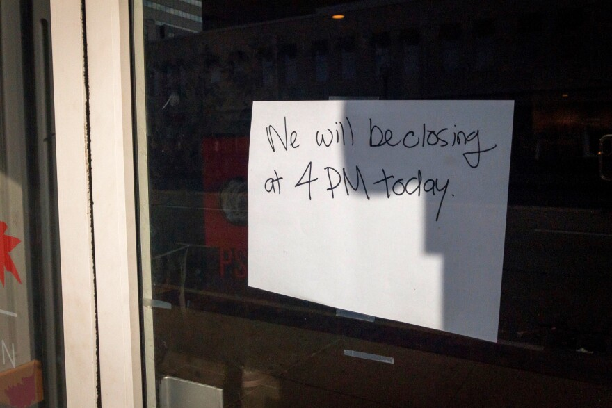 A sign taped to the door at a Starbucks in Clayton indicated the business would close early on Wednesday ahead of protests planned in the area for 5 p.m.