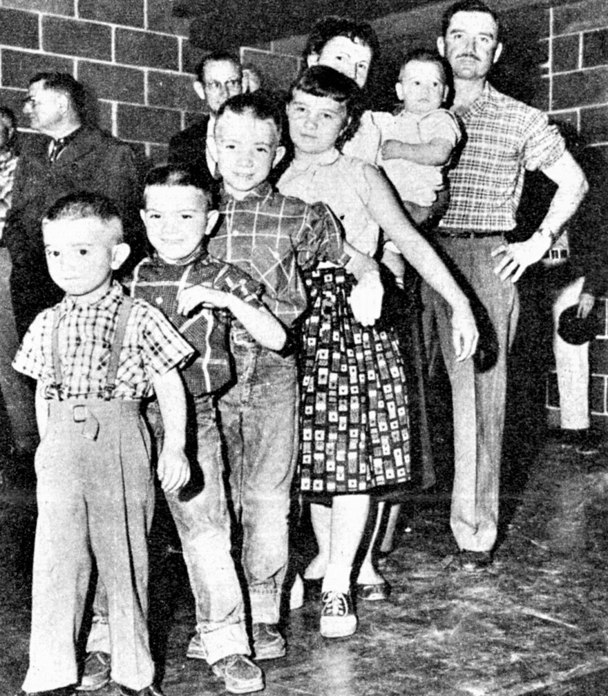 The Herd family of Protection, Kansas, on the day they joined other residents of the community in getting inoculated against polio. Steve Herd is third from the front. His younger brother, Stan, is directly in front of him.
