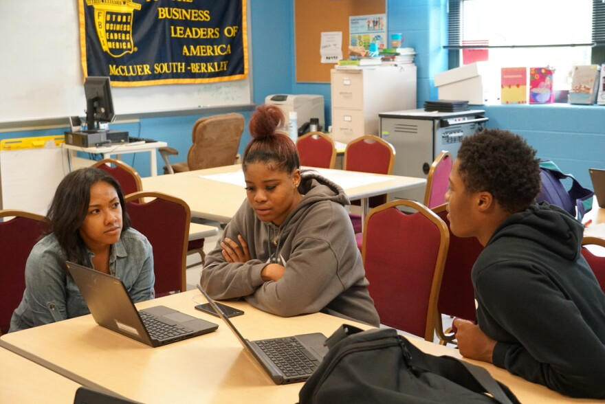 Chyna Bowen assists several students at McCluer South Berkeley who participated in the St. Louis Youth Entrepreneurship Challenge. May 3, 2019