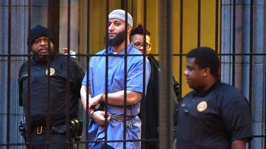 Adnan Syed, subject of the podcast <em>Serial</em>, is escorted from a courthouse in February 2016. An appellate court has upheld a previous decision to vacate Syed's 2000 conviction