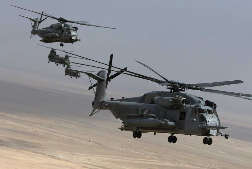 CH-53E and Chinook helicopters with U.S. Marines take off from Camp Bastion in Helmand province, on Monday.