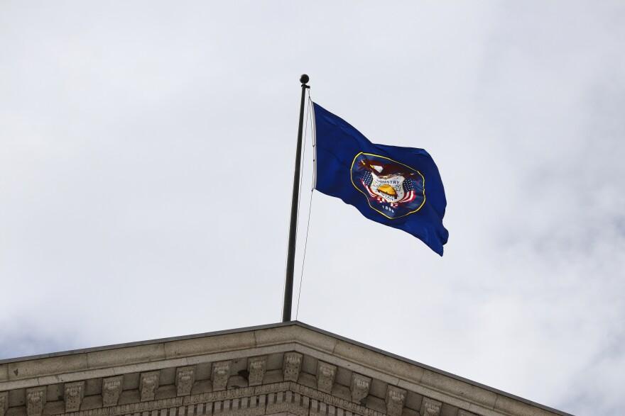 Photo of flag on Utah Capitol.