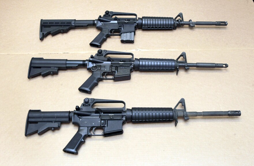 In this Aug. 15, 2012 file photo, three variations of the AR-15 rifle are displayed at the California Department of Justice in Sacramento, Calif. On Sept. 19, 2019, Connecticut-based Colt Firearms said it was suspending production of its version of the AR-15 for the civilian market.