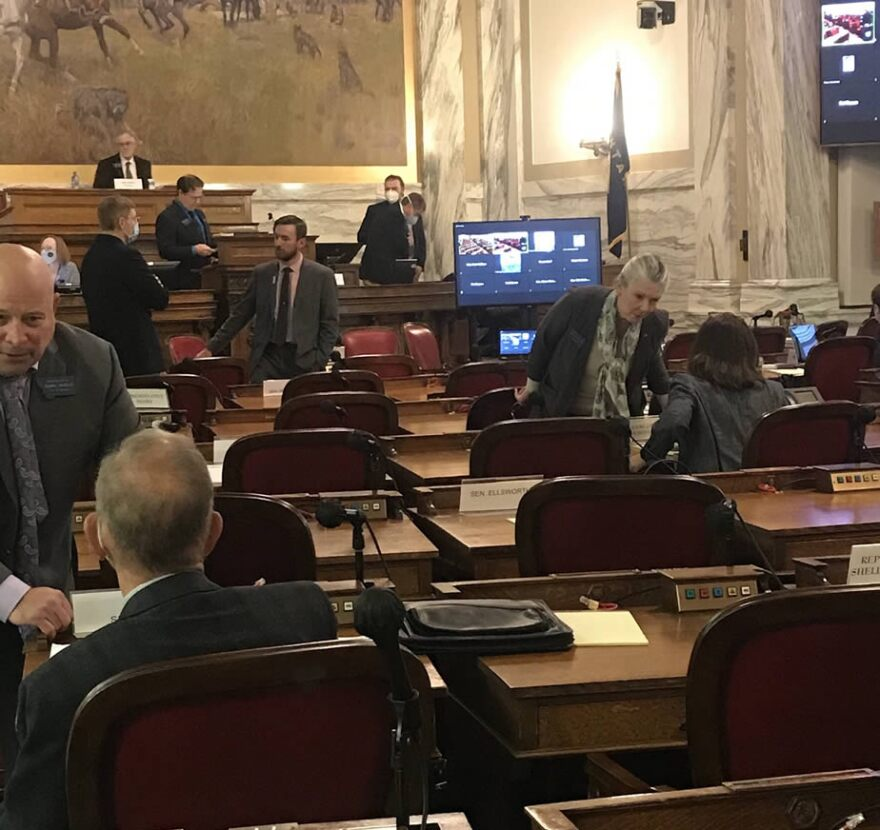 Lawmakers talk after the Montana Legislature rules committee adjourned, December 08, 2020.