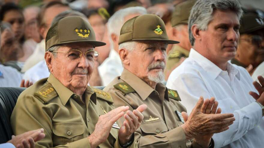 Cuban President Raúl Castro (left), Commander of the Revolution Ramiro Valdés (center) and Cuban Vice President Miguel Díaz-Canel sit side by side at the Artemisa Mausoleum monument in July 2014.