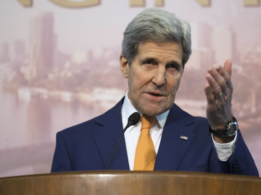 Secretary of State John Kerry told CBS News the U.S. is pushing for Syrian President Bashar Assad to seriously discuss a transition strategy to quell the Arab country's four-year civil war.