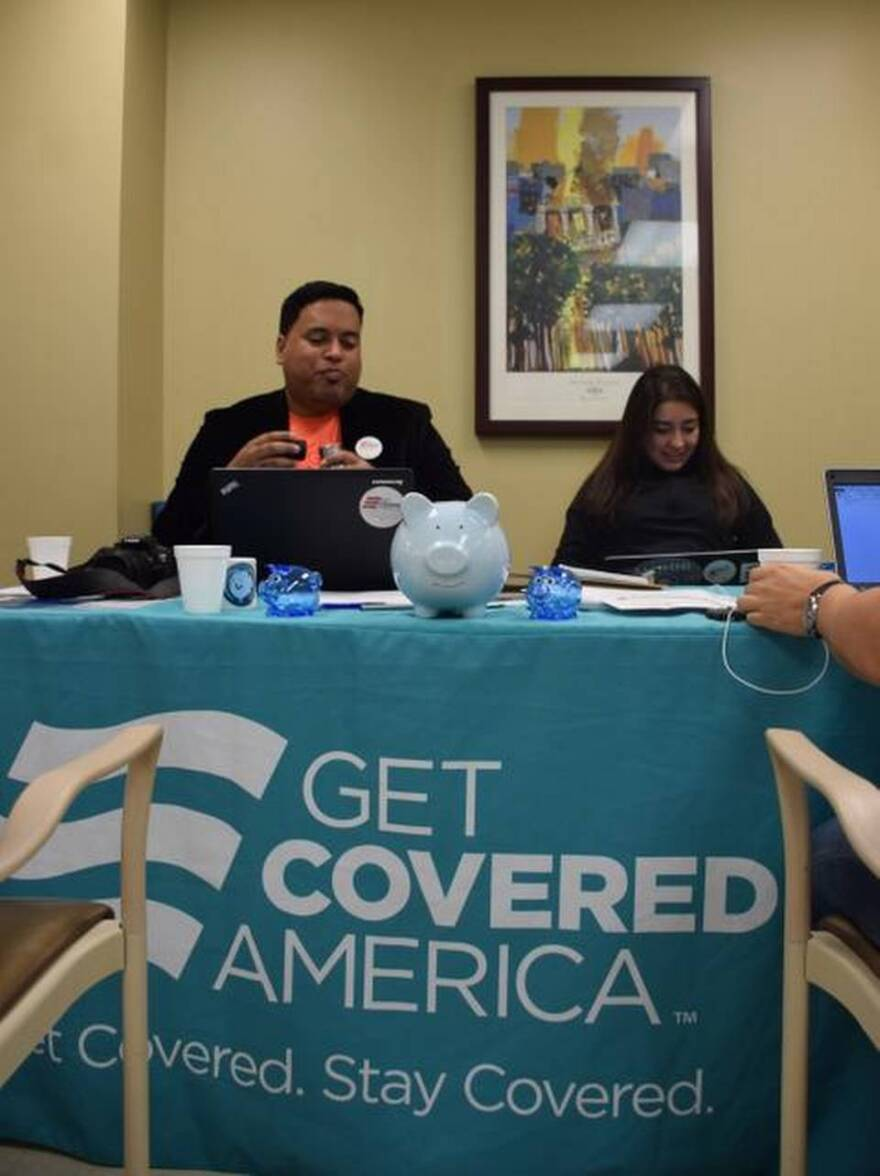 Milton Vazquez, Florida spokesman for nonprofit organization Enroll America, and Denise López Martinez, an Enroll America volunteer, attend an Obamacare sign up event at Hialeah Hospital on Feb. 15, the end the final day of open enrollment this year.