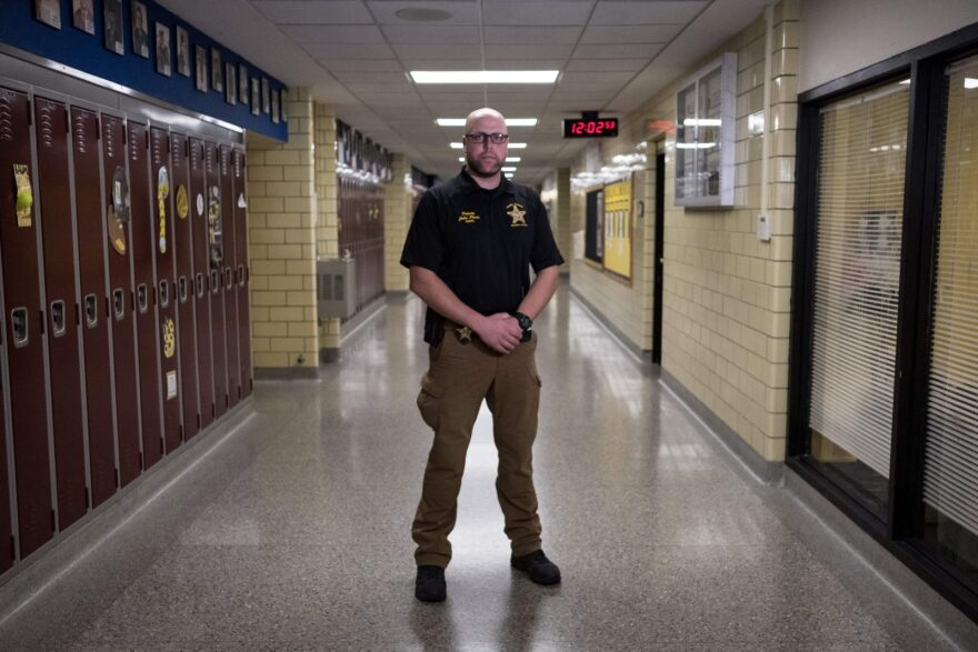 School resource officer, John Pence poses at Sidney High School in Ohio in 2019. School districts around the country are ending or reexamining their contracts with local police departments in the wake of George's Floyd's killing.