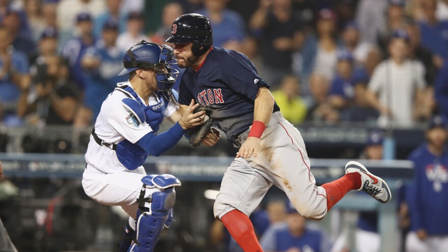 """""""In a closed society where everybody's guilty, the only crime is getting caught. In a world of thieves, the only final sin is stupidity."""" Ian Kinsler of the Boston Red Sox is tagged out at home plate in the 10th inning early Saturday by Austin Barnes of the Los Angeles Dodgers on a throw from outfielder Cody Bellinger."""