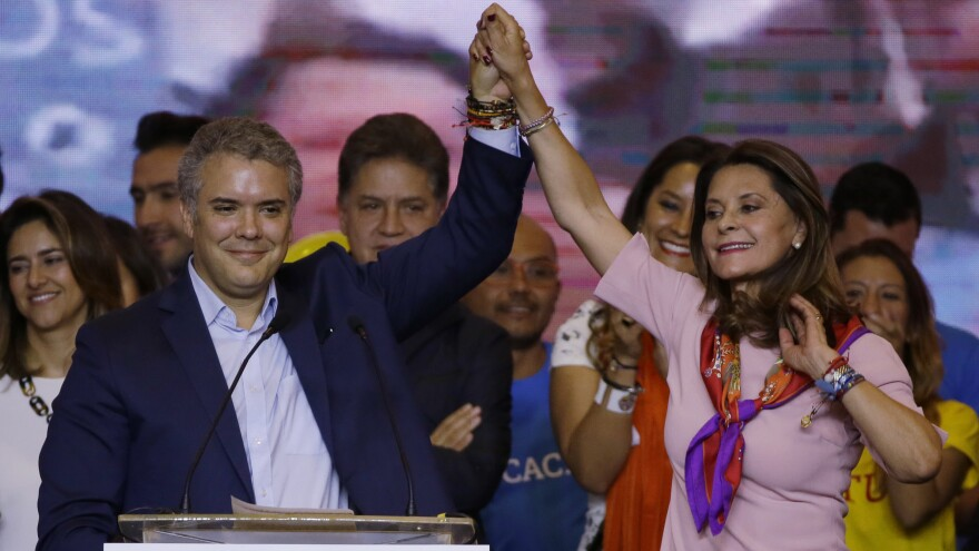 Ivan Duque, presidential candidate for the Democratic Center, and his vice presidential candidate Marta Lucia Ramirez, raise arms after winning the first round of Colombia's presidential election. A runoff with Gustavo Petro will be held June 17.