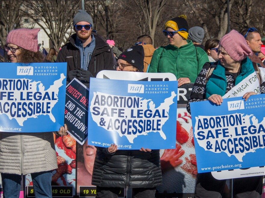 Abortion rights supporters stand in front of opponents during the Women's March on Saturday, Jan. 20 in Washington, D.C.. The march was held one day after the 45th annual March for Life.