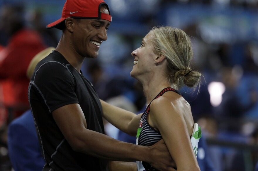Eaton greets his wife, Brianne Theisen Eaton, of Canada, after she took bronze in the women's heptathlon on Saturday.