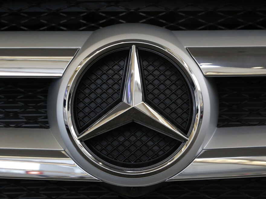 The Mercedes logo in the grille of a Mercedes 2016 GLE SUV automobile on display at the Auto Show in Pittsburgh.
