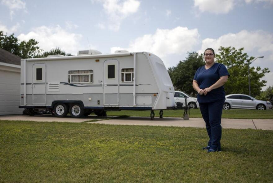 Marissa Hudler standing in front of the RV.