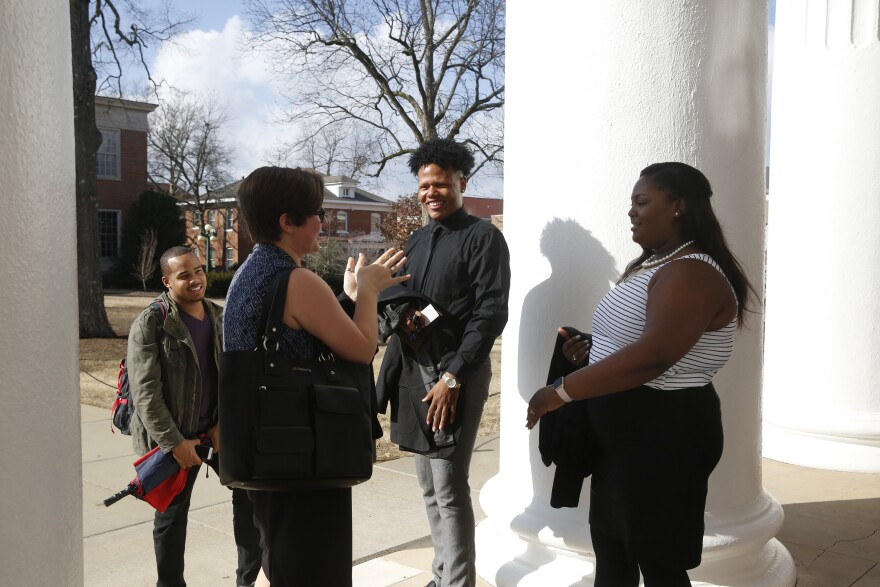 Johnson talks with his friends on campus.