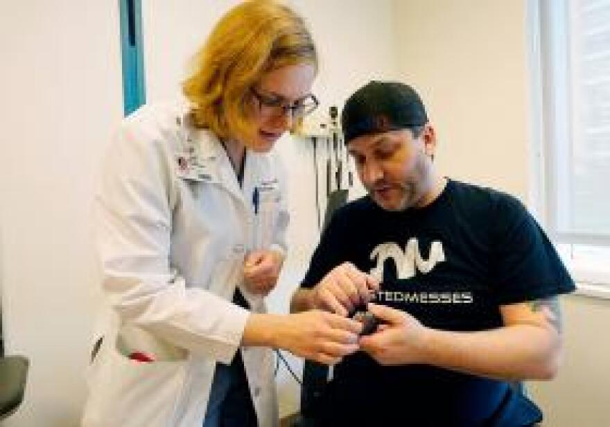 Dr. Erika Petersen and patient Jared Jackson discuss the nerve block device