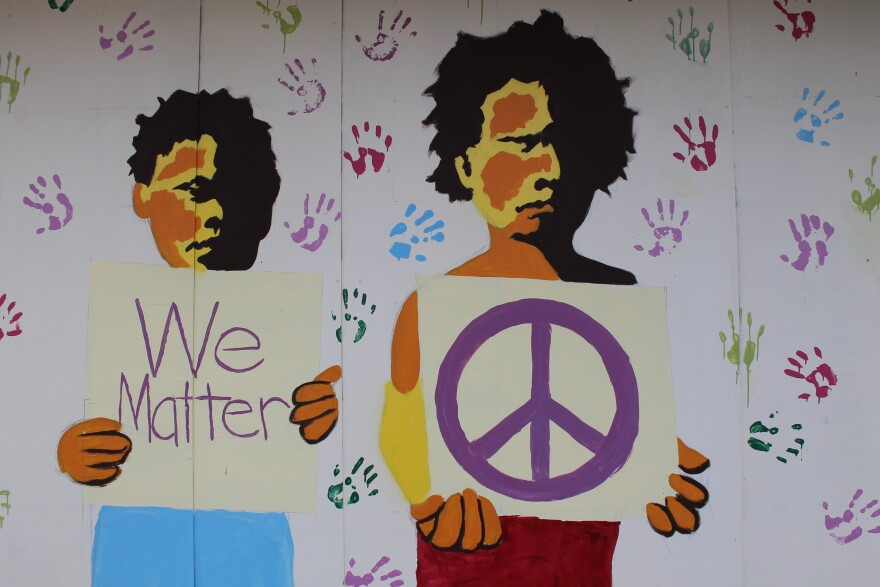 One of the many plywood murals that appeared in Ferguson after the grand jury decision.
