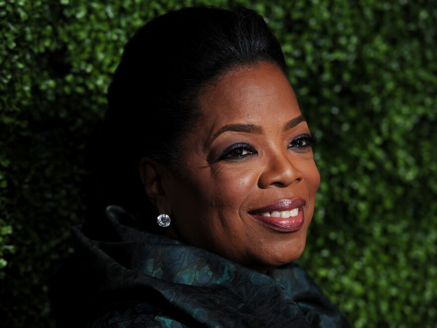 The White House cited Oprah Winfrey's philanthropy and work to expand opportunities for young women in awarding her a Presidential Medal of Freedom.