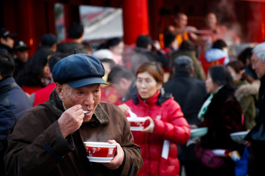 Citizens eat Laba congee, or rice porridge, at Guangren Temple at the Laba Festival, a traditional Chinese holiday, in Xi'an, Shaanxi Province of China. Cultures around the world have long embraced porridges.