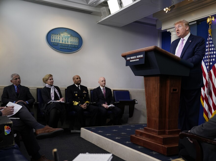 President Donald Trump speaks during a coronavirus task force briefing at the White Houseon Friday. Seated from left, Director of the National Institute of Allergy and Infectious Diseases Dr. Anthony Fauci, White House coronavirus response coordinator Dr. Deborah Birx, Surgeon General Jerome Adams, and Food and Drug Administration Commissioner Dr. Stephen Hahn.