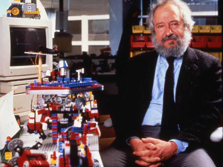 Seymour Papert with LEGO Mindstorms robotics kits, which were named in recognition of Papert's seminal book, <em>Mindstorms: Children, Computers, and Powerful Ideas.</em>