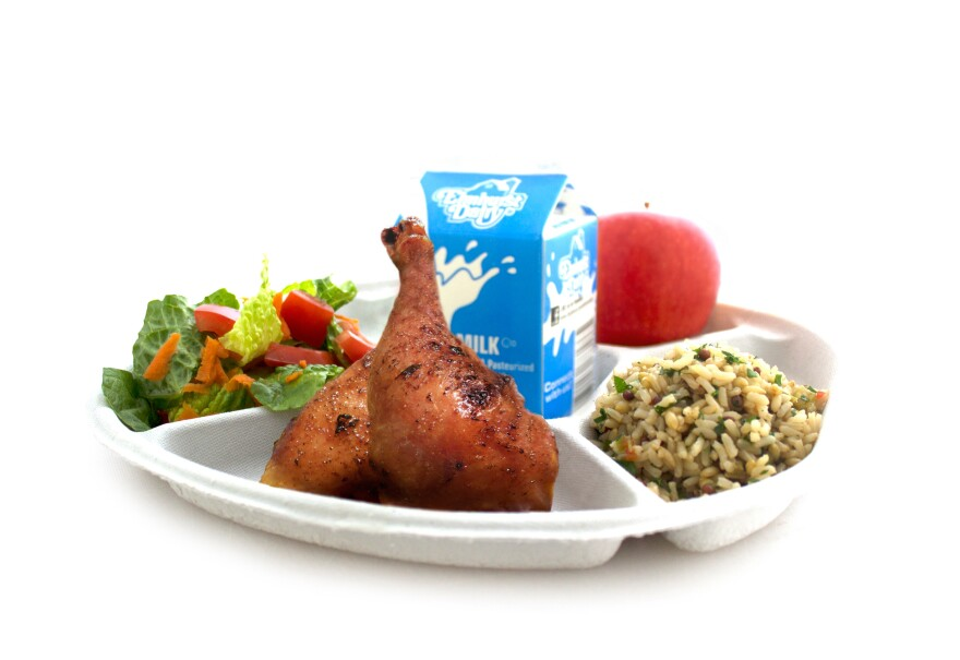 The new lunch plates are made from recycled newsprint and are easier for kids to hold, says Eric Goldstein, chairman of the Urban School Food Alliance.