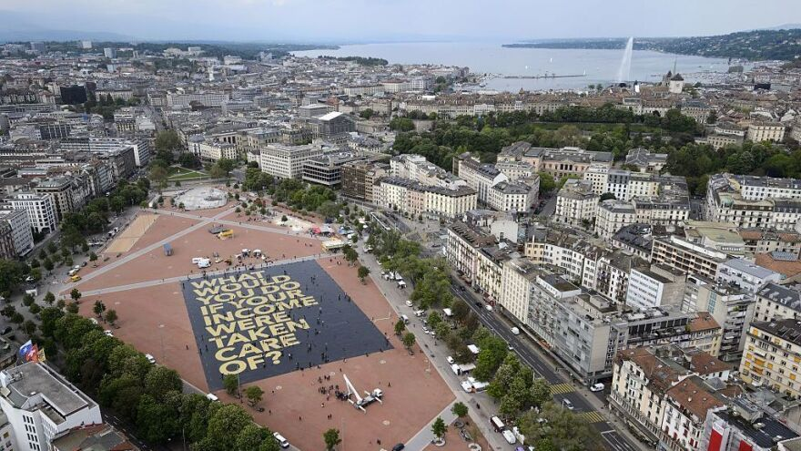 """A giant poster in Geneva reading """"What would you do if your income was taken care of?"""" ahead of Switzerland's  vote on a proposed """"basic income"""" set the <a href=""""http://www.guinnessworldrecords.com/news/charity/2016/5/swiss-group-creates-largest-poster-ever-to-support-vote-for-basic-income-429715"""">Guinness World Record</a> for the largest poster ever printed."""