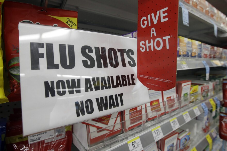 In this file photo, a sign telling customers that they can get a flu shot in a Walgreen store is seen in Indianapolis. (Darron Cummings/AP)
