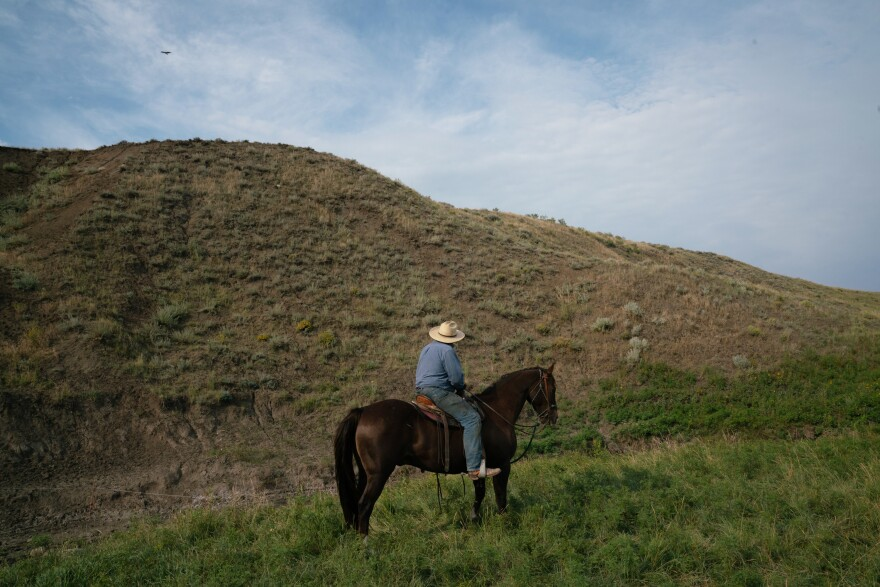 Craig French rides a horse on his ranchland. While some ranchers in this pocket of the Great Plains overgrazed their spreads and plowed up native grasses, most did a good job taking care of it.