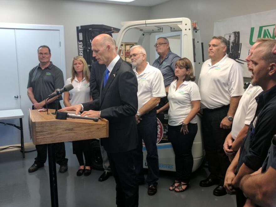 Rick Scott speaks at Florida Forklift in Jacksonville Wednesday.