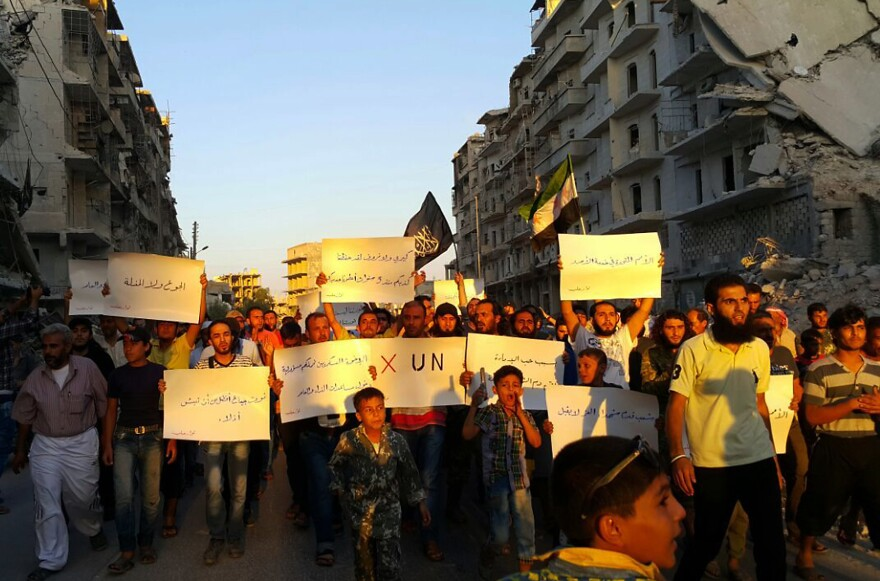 """Activists in Syria's besieged city of Aleppo protest Tuesday against the United Nations for what they say is its failure to lift the siege of their rebel-held area. """"Hunger better than humiliation,"""" one banner read. """"X the UN,"""" another declared."""