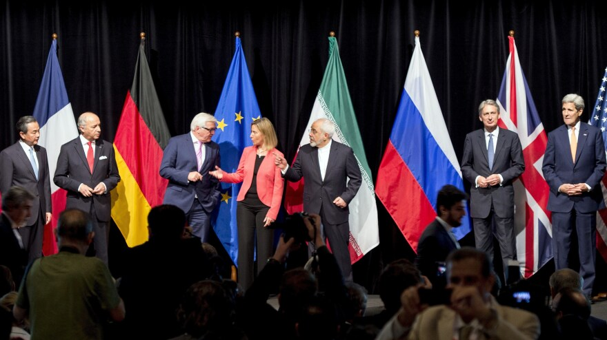 A slew of foreign ministers — including former Secretary of State John Kerry (far right) — pose for pictures in July 2015, not long after finalizing the Iran nuclear deal in Vienna.