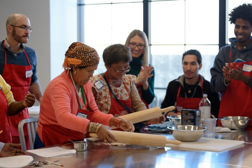 Teela Magar and Cing Neam prepare the roti dough as part of Edible Alphabet, a program in Philadelphia that folds English lessons for new immigrants to the U.S. into a cooking class. Students also learn about seasonality and healthful eating on a budget.