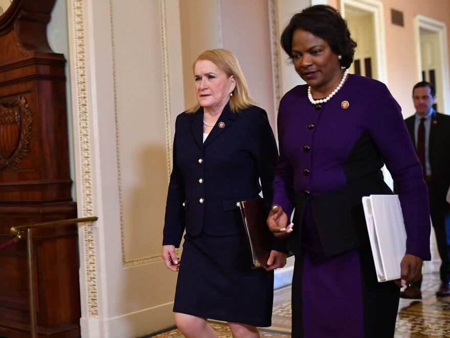 House impeachment managers Reps. Val Demings, right, and Sylvia Garcia arrive for closing statements in President Trump's impeachment trial.
