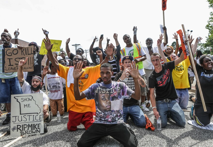 People protest in Ferguson on Aug. 30, 2014.