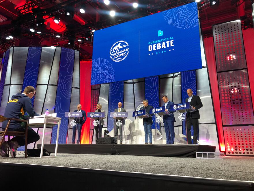 Photo of the gubernatorial candidates on stage for their first debate.