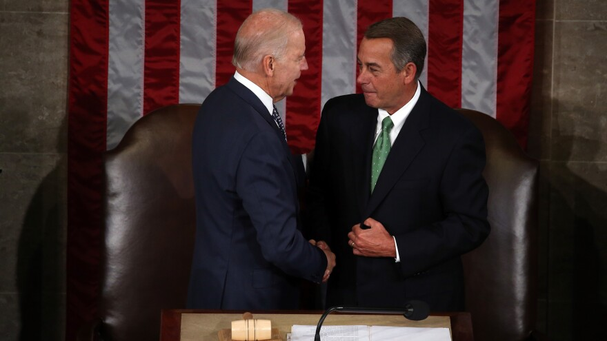 Vice President Joe Biden (left) and Speaker of the House John Boehner shake hands prior to Pope Francis speech to Congress on Thursday.