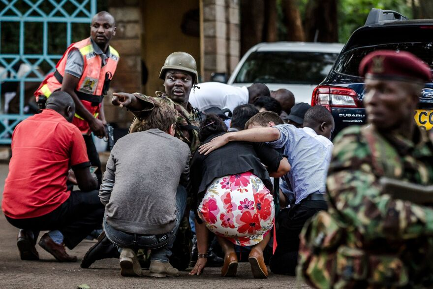 Special forces protect people at the scene of an explosion at a hotel complex in Nairobi on on Tuesday. The attack has been claimed by Al-Shabab, a Somalia-based terrorist group.