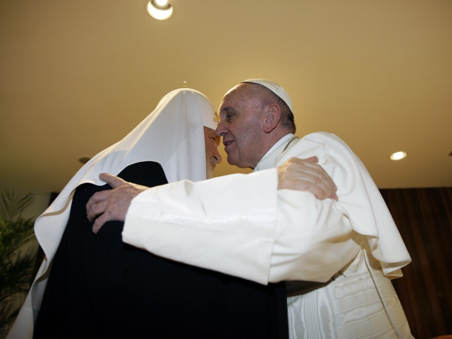 The head of the Russian Orthodox Church, Patriarch Kirill (left), kisses Pope Francis as they meet at José Martí International Airport in Havana on Friday.