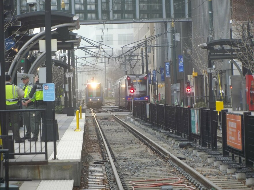 Two trains pass near 7th Street Station uptown.