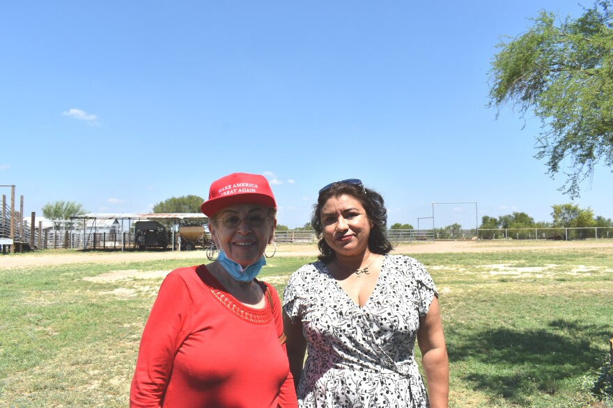 Sylvia Cervantes (left) poses for a picture with other Latinas at Webb County Republican Party meeting in late August.