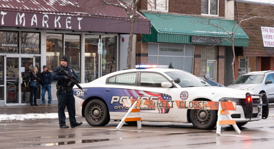 A Missoula police officer stands at a barricade in front of the courthouse, Feb. 12, 2020. Police say shots were fired at a police car earlier in the day.